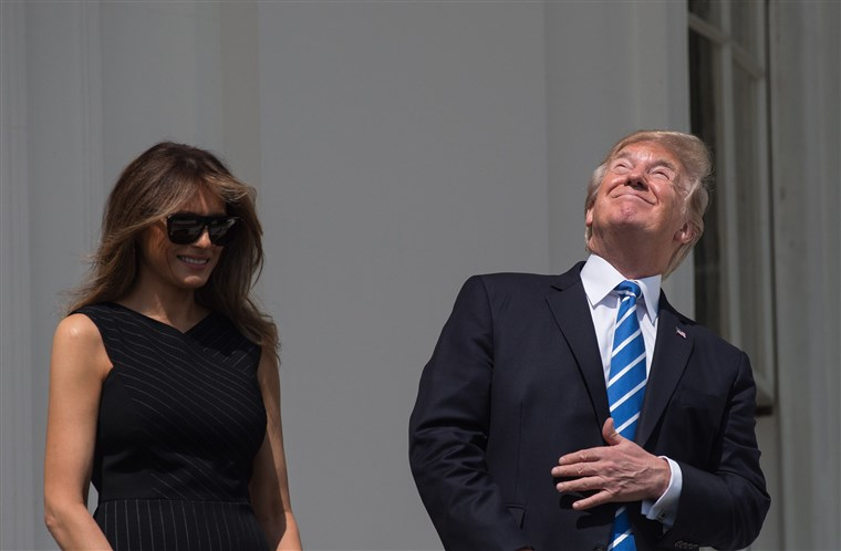 US President Donald Trump Looking Directly at the Eclipse
